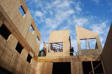 Workers installing the wood wall panels manufactured by Reliable Truss. Picture from Nauset Construction (www.nausetconstruction.com)
