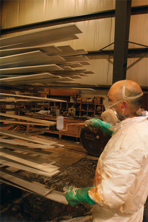 Russin man applying coating to end of a substrate of Factory Finished trim and siding image