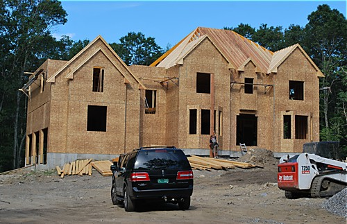 Custom-built home by Heritage Construction with pre-cut rafters supplied by Reliable Truss, a division of National Lumber