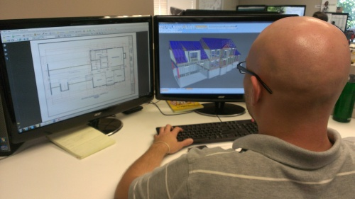 One of National Lumber's engineers working on MiTek Sapphire Building Information Modeling Software.