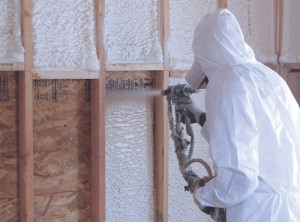 Closed cell spray foam insulation being applied