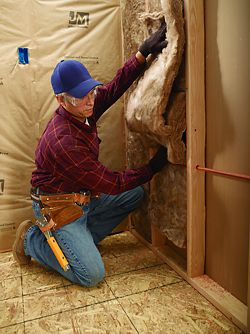 johns-manville-18590395-contractor-installing-insulation